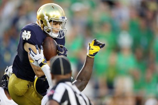 Chris Finke #10 of the Notre Dame Fighting Irish scores a first quarter touchdown against the Michigan Wolverines at Notre Dame Stadium on Sept. 1, 2018 in South Bend.