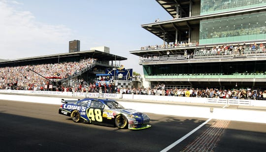 Driver Jimmie Johnson won the 15th Brickyard race. Here he crosses the finish line for the win. Fans rolled into the Indianapolis Motor Speedway for the Allstate 400 race at the Brickyard on Sunday, July 27, 2008. (Sam Riche / The Indianapolis Star)