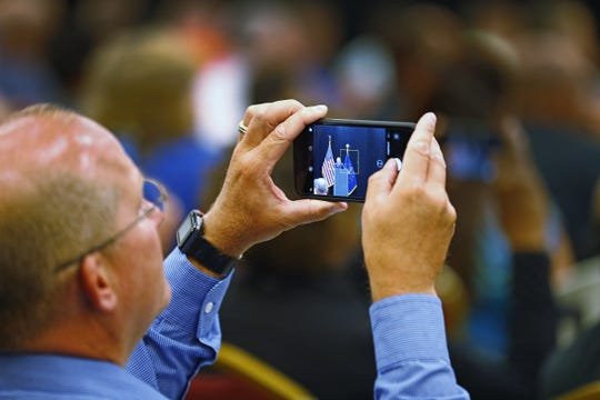 People take photos as U.S. Attorney General Jeff Sessions speaks at the 2018 Indiana Law Enforcement Conference at the Indianapolis Marriott East, Thursday, Sept. 6, 2018.