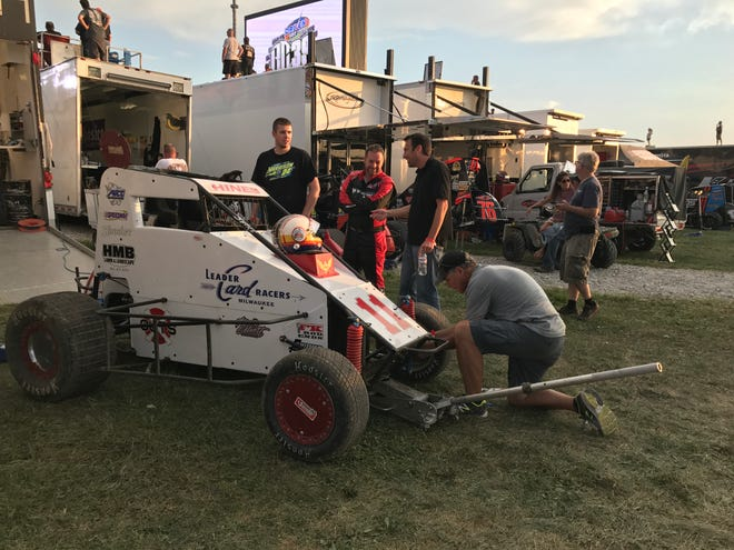 The No. 11 Leader Card Racers car is prepared  for dirt-track racing at Indianapolis Motor Speedway. That team has a long history at the track.