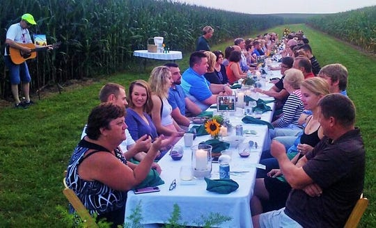This crowd of about 90 enjoyed a serene, four-course meal in a cornfield north of Atkins last month. It's the unique annual fundraiser for Four Oaks of Cedar Rapids in cooperation with Bloomsbury Farm.