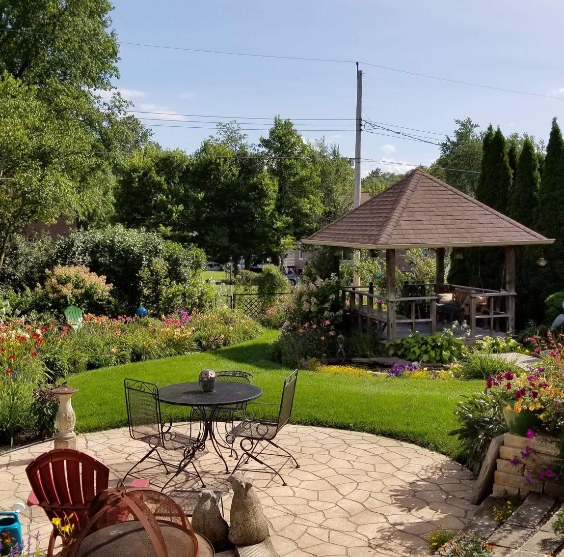 From lily pads to roses, this Iowa City backyard garden is one to behold