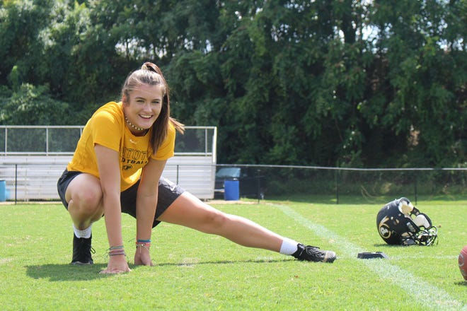 Pontotoc kicker Taylor Hughes smiles as she stretches before a football practice at Pontotoc High School on Aug. 27, 2018.