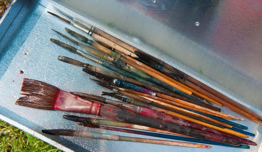 Mixed among a tray of Paul Gore's tools of the trade are some of the original 50-year-old brushes his father gave him to use on his very first job when his was 14 years old. He still uses them.