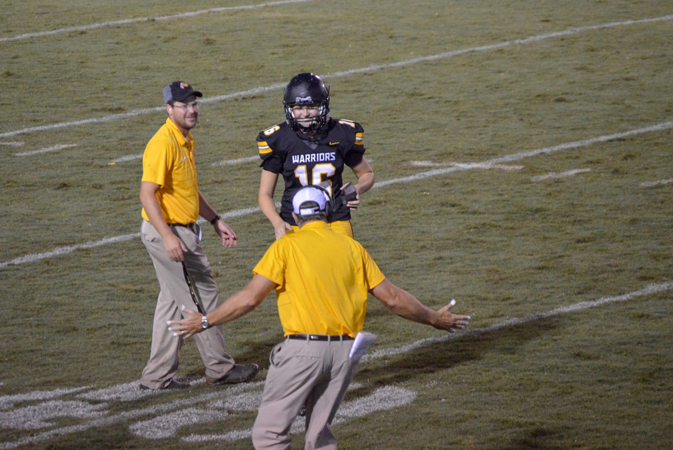 Pontotoc head coach Jeff Carter congratulates Taylor Hughes after she kicked a touchback in her final high school football game on Aug. 31, 2018.