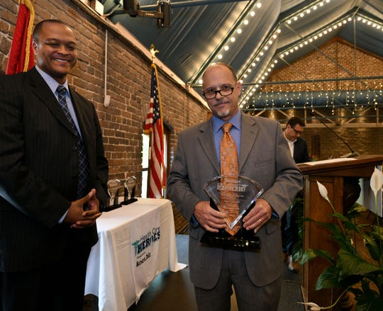 Clinical resource nurse at UT Medical Center David Trout accepts his award at the Knox.biz Health Care Heroes luncheon at the Foundry on Thursday, Sept. 6, 2018.