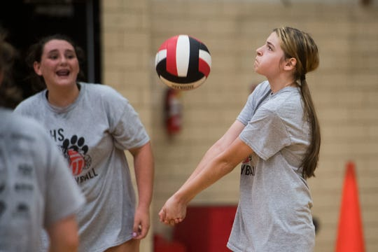 Sophomore Hannah Vogt bumps the ball during a Central High School girls volleyball practice in the school gym Wednesday, Sept. 5, 2018. Hannah joined the team this season after girls volleyball coach Lorri Johnson discovered her in a special education class Johnson was a teachers aide in.
