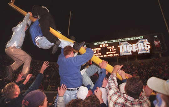 University of Memphis fans tear down the goal post on the south side of the Liberty Bowl after the Tigers' stunning 21-17 upset of the Vols on Nov. 9, 1996.