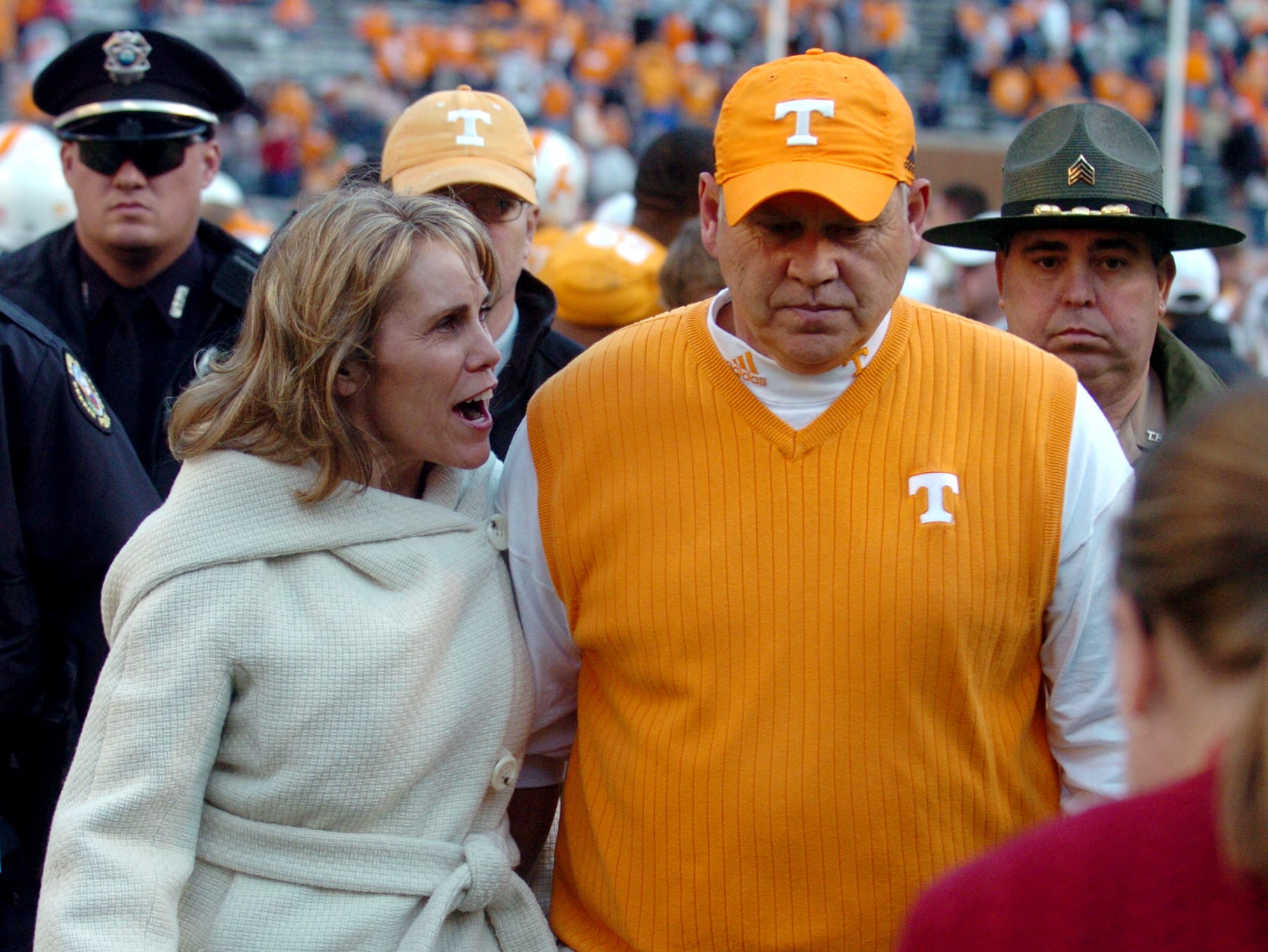 Head coach Phillip Fulmer and his wife, Vicky, walk off the field after Tennessee's 13-7 homecoming game loss to the University of Wyoming Cowboys on Nov. 8, 2008, in Neyland Stadium.