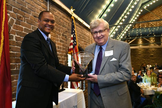 Dr. John Ingram is honored at the Knox.biz Health Care Heroes luncheon Thursday, Sept. 6, 2018, at the Foundry.