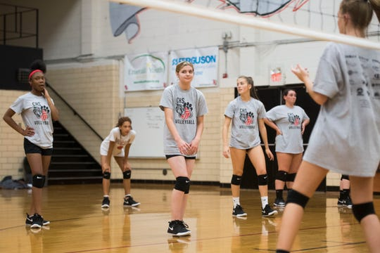 Sophomore Hannah Vogt stands amongst teammates at a Central High School girls volleyball practice in the school gym Wednesday, Sept. 5, 2018. Hannah joined the team this season after girls volleyball coach Lorri Johnson discovered her in a special education class Johnson was a teachers aide in.