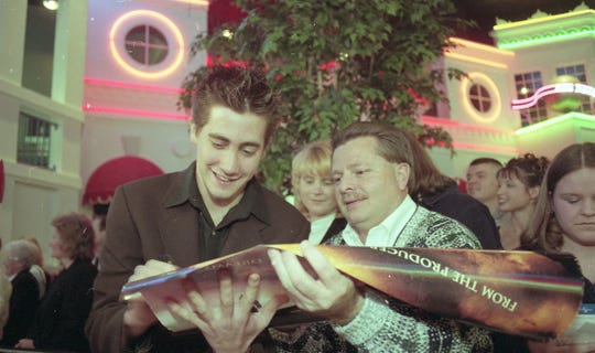 Actor Jake Gyllenhaal, left, signs an autograph for Anderson County Commissioner Wimp Shoopman, right before the Southern premiere of the Universal Pictures film 'October Sky'  at Regal Cinemas West Town Mall 9, Feb. 16, 1999.