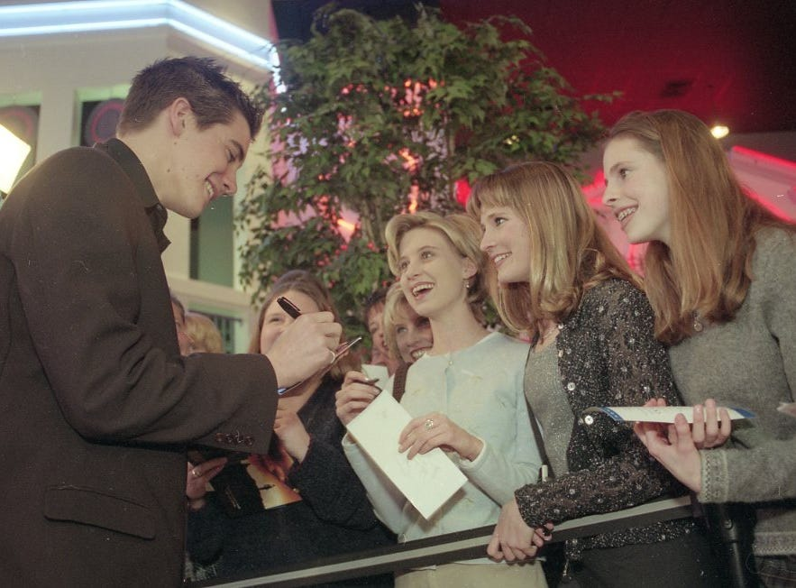 Actor Jake Gyllenhaal, who played the lead role of Homer Hickam, signs autographs before the Southern Premiere of the Universal Pictures film 'October Sky' at Regal Cinemas West Town Mall 9, Feb. 16, 1999. The autograph seekers are, from right, Amanda Shoopman, 15, Kelli Shoopman, 16, and Kristen Wright, 18.