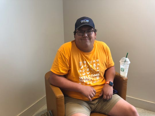 "UTK Freshman Troy Perry sits in Starbucks in Hodges Library on Thursday, September 6. Perry said he didn't think the no smoking policy would have an impact on how many people smoke on game day. ""Students will do whatever they want,"" Perry said."
