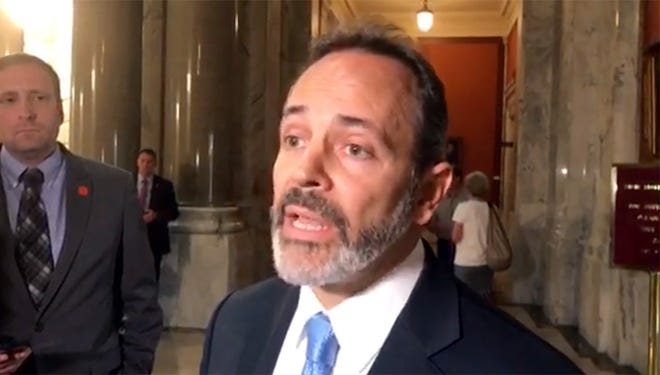 Gov. Matt Bevin talked to reporters at the Capitol about the qualifications of Charles Grindle.