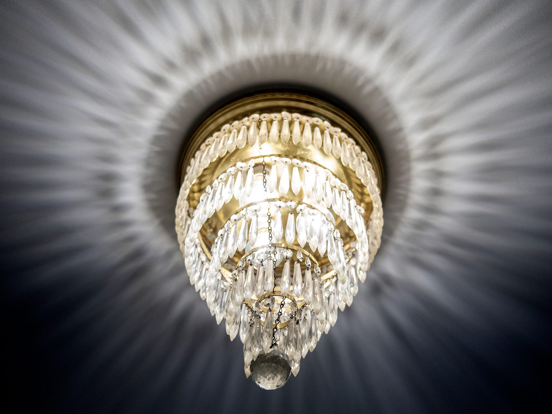 A light fixture casts an interesting reflection on the ceiling at the Purchases' Moores River Drive home on Thursday, Sept. 5, 2018, Lansing. The home is one of five homes that will be featured on the Sept. 16 Lansing Area Historical Home Tour.