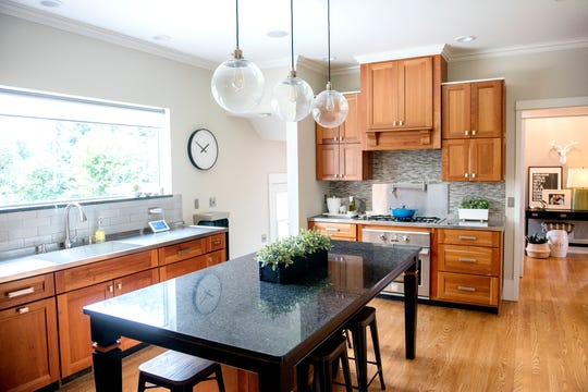The kitchen at the Purchases' Moores River Drive home on Thursday, Sept. 5, 2018, Lansing. The home is one of five homes that will be featured on the Sept. 16 Lansing Area Historical Home Tour.