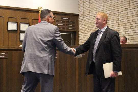 Ontario Mayor Randy Hutchinson, left, shakes hands with Joe Trolian, executive director of the Richland County Mental Health and Recovery Services Board, at Ontario City Council on Wednesday, Sept. 5, 2018. Hutchinson read a proclamation declaring September National Recovery Month.