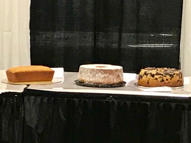 Guess which cake Rob McCurdy baked for the Ohio State Fair competition? If you picked the one on the left and not the two pretty cakes beside it, you would be right.