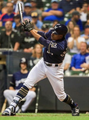 Curtis Granderson follows through on his two-run homer for the Brewers against the Cubs in the seventh inning Wednesday night.