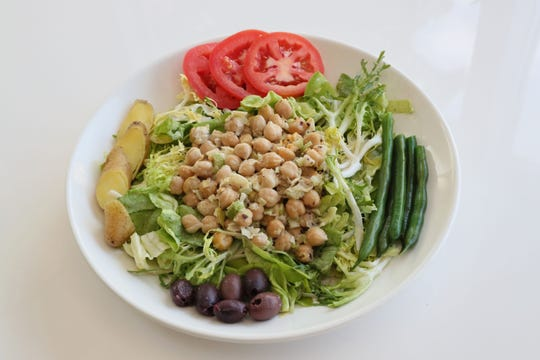 A vegan version of Nicoise salad, with chickpeas at the center.