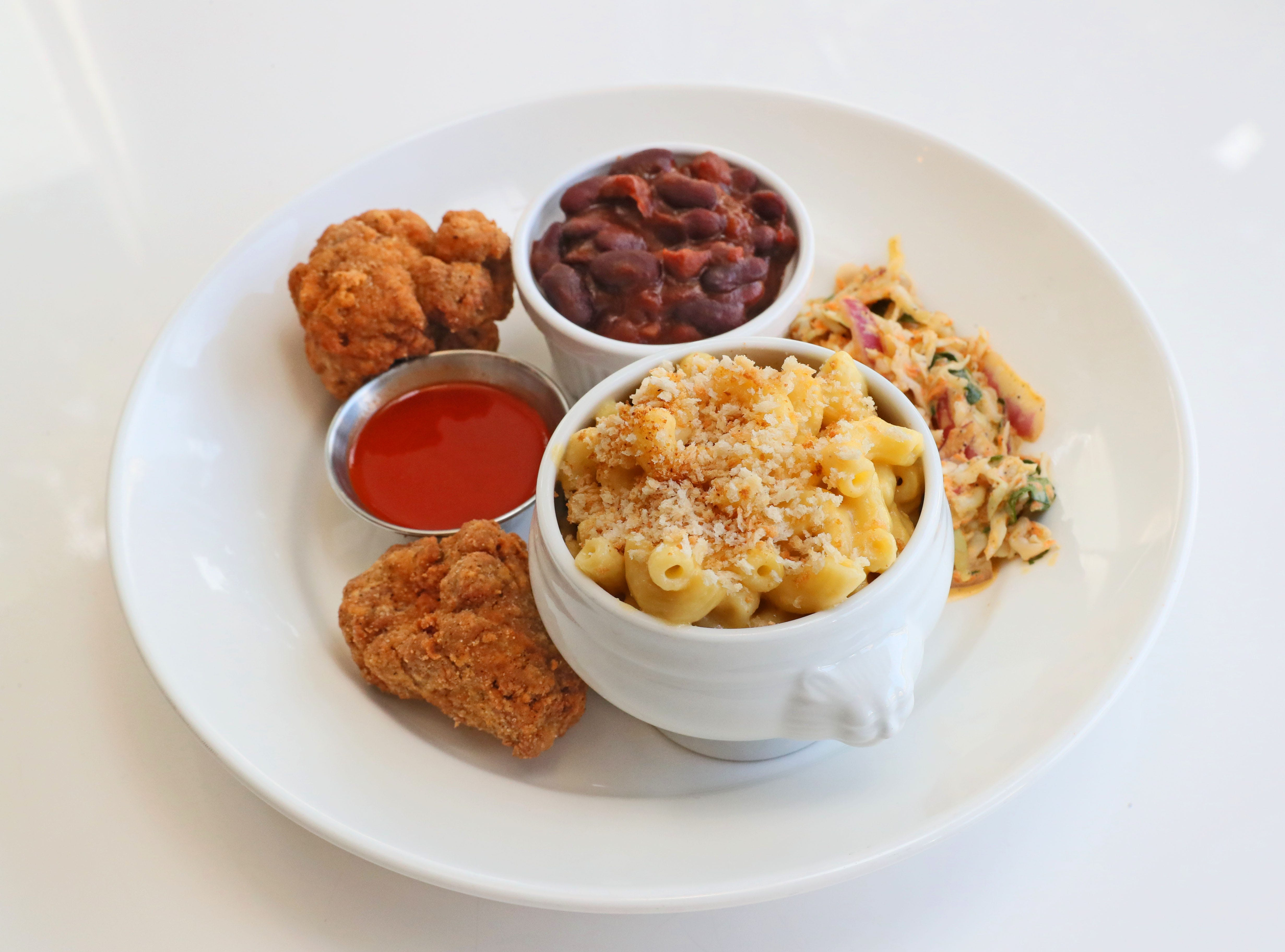"The Southern Plate at Celesta serves mac and ""cheese,"" baked beans and coleslaw with battered and fried seitan.  The ""cheese"" is built on soy cream."