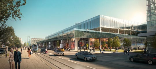 Conceptual plans for redeveloping the U.S. Postal Service's downtown Milwaukee facility include shops, restaurants and offices.