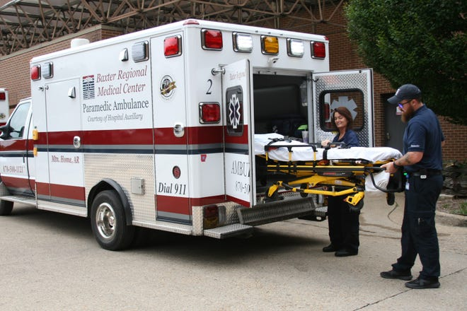Baxter Regional Medical Center paramedics Kissie Clark and Jonathan Belt load up their ambulance after delivering a patient to the BMRC emergency department. From now until the end of October, the Baxter Regional Hospital Foundation is campaigning to raise $200,000 to replace two aging ambulances from BMRC's fleet that have more than 500,000 miles on them.