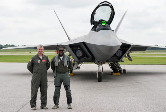 "Col. Ed Casey and Pilot Maj. Paul ""Loco"" Lopez pose in front of his F-22 Raptor fighter jet at the Montgomery Regional Airport in Montgomery, Ala., on Thursday, Sept. 6, 2018."