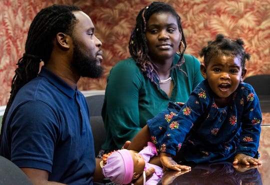 Robert and Rickynna Smith and their daughter Reign talk about the Fathers in Action and Parents as Teachers programs at the Gift of Life offices in Montgomery, Ala., on Thursday September 6, 2018.