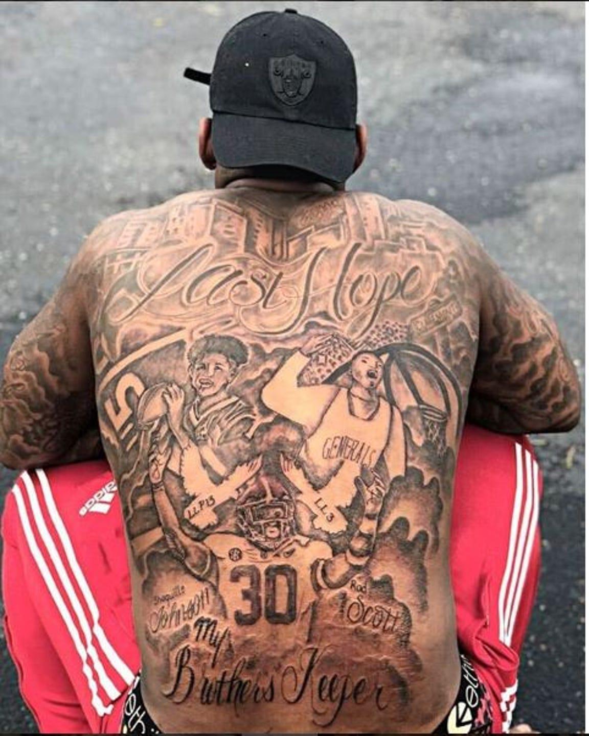 Tattoo artist Michael Jordan drew the tattoos on Mack Wilson's back in tribute to fallen loved ones Rod Scott and Shaquille Johnson.