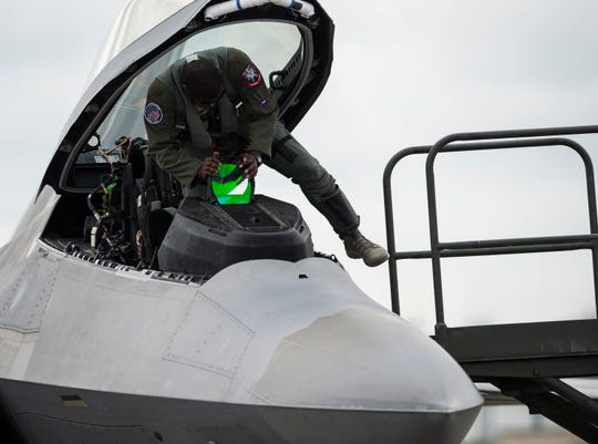 """Pilot Maj. Paul """"Loco"""" Lopez steps out of his F-22 Raptor fighter jet at the Montgomery Regional Airport in Montgomery, Ala., on Thursday, Sept. 6, 2018."""