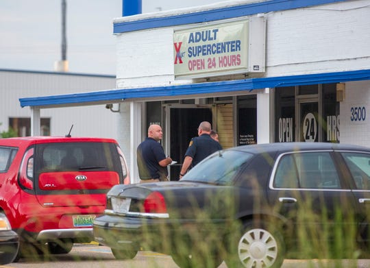 Montgomery police investigated the scene where an employee of the X-Mart Adult Supercenter was shot during a robbery.