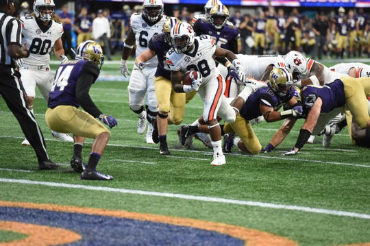 Auburn running back JaTarvious Whitlow (28) scores a touchdown in the fouth quarter against Washington on, Saturday, September 1, 2018, in Atlanta.