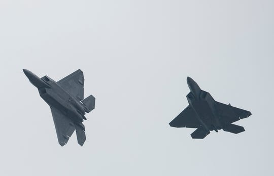 Two F-22 Raptor fighter jets fly at the Montgomery Regional Airport in Montgomery, Ala., on Thursday, Sept. 6, 2018.