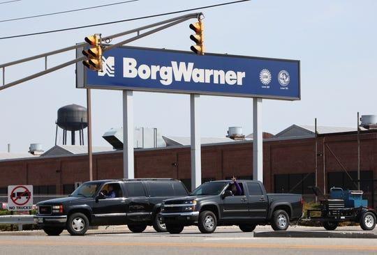 BorgWarner employees leave the factory the afternoon of April 9, 2009, the day production ceased.