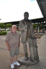 Bob Good stands next to the statue of Charles Willard.