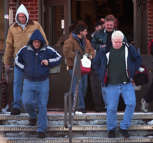 Dayshift employees at the Muncie BorgWarner plant leave work on Feb. 8, 2007, after learning the plant will close by April 2009.