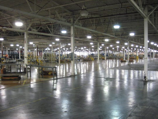 Lights high overhead illuminate a portion of the cavernous, half-mile-long former BorgWarner Automotive plant during a June 2009 auction.