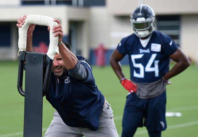 Tennessee Titans head coach Mike Vrabel works with  linebacker Rashaan Evans (54) during practice at Saint Thomas Sports Park Thursday, Sept. 6, 2018, in Nashville, Tenn.