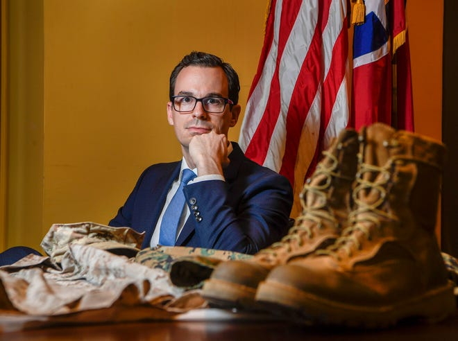 Aaron Dorn, president, CEO and founder of Nashville upstart Studio Bank, donated his uniforms that he wore while serving as a Marine in Afghanistan to the Tennessee State Museum.