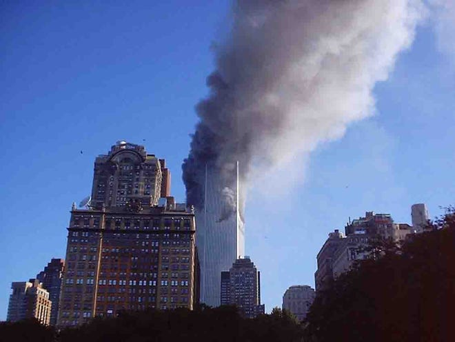 Fairview resident Cindy New captured this photo of the Twin Towers shortly after the terrorist attack on September 11, 2001, and before the towers fell.