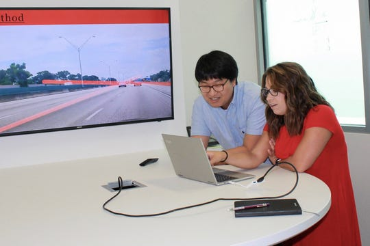 APSU senior Jordan Miller shows her program to Florida Atlantic University mentor Dr. Jinwoo Jang during her summer undergraduate research project. Miller researched a self-driving car program to help identify and report missing or incomplete lanes on roads.
