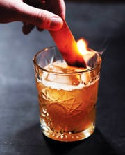 The Vesta is a Corsair signature cocktail made of Triple Smoke Whiskey, lemon, honey and ginger, and garnished with burnt cedar.