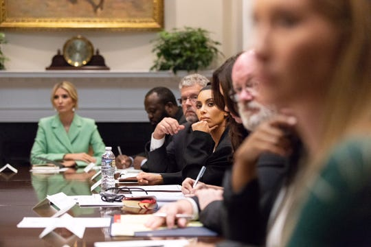 Former federal judge Kevin Sharp, of Nashville, listens next to Kim Kardashian West during a discussion about criminal justice reform and clemency on Wednesday, Sept. 5, 2018.