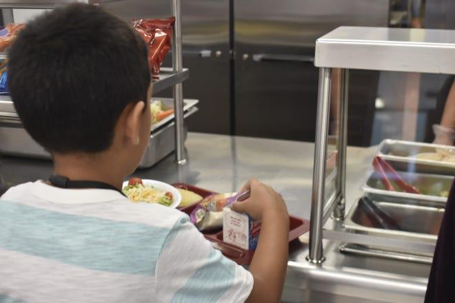 Ashland City Elementary School fourth-graders buy lunch on Thursday, Sept. 6.