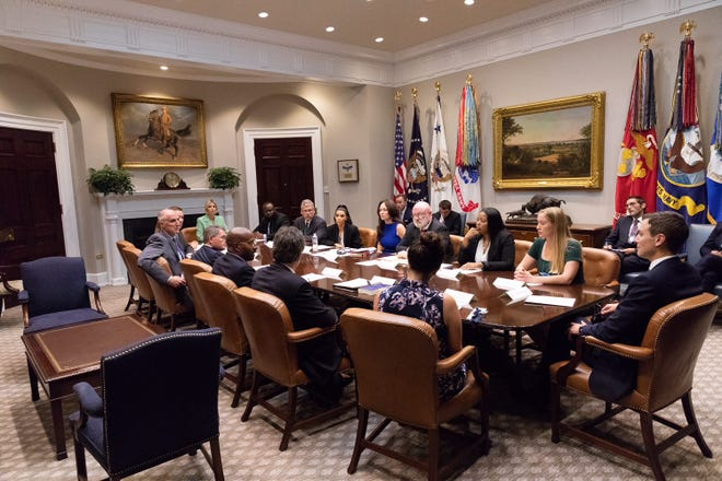 A group of visitors to the White House, including former Nashville judge Kevin Sharp, sitting to the right of Kim Kardashian West, discuss criminal justice reform and clemency on Wednesday, Sept. 5, 2018.