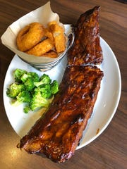 "Duffy's Sports Grill's ""Baby Back Ribs."" Grilled and basted with signature sauce, full rack, $19.99."