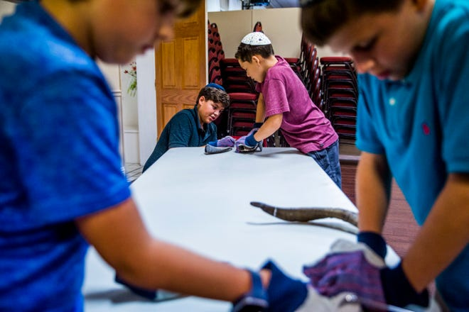 Kids learn how to make their own shofars, which are sounded at Rosh Hashana, at the Chabad Naples Jewish Community Center on Wednesday, Sept. 5, 2018.
