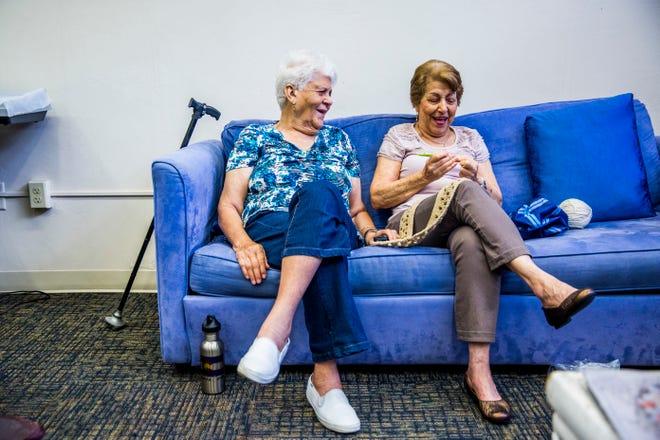 Juanita Jerez, 91, left, and Edi Vargas, 84, laugh together during a knitting club meeting at Golden Gate Senior Center in Golden Gate on Thursday, Sept. 6, 2018.